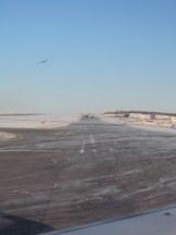 Snow swirling across the runways